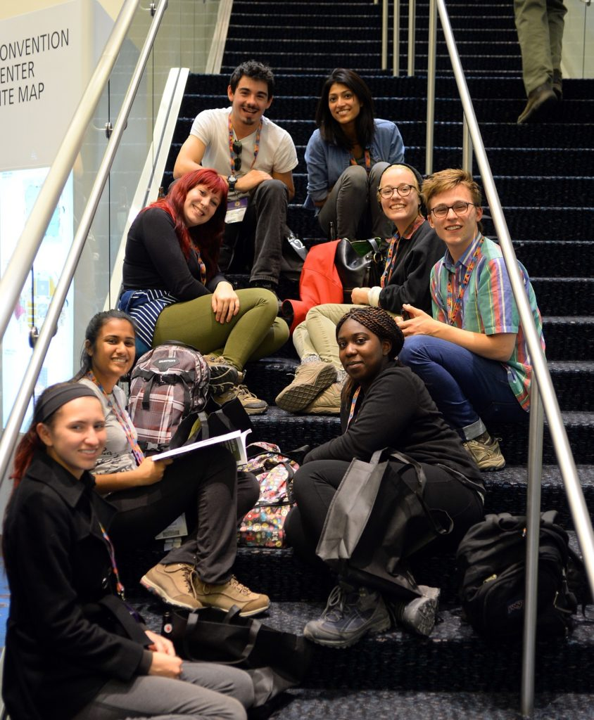 OTF students on stairs at convention center