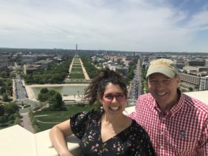 Caitlin Keating-Bitonti with U.S. Senator Tom Udall at the top of the Capitol.